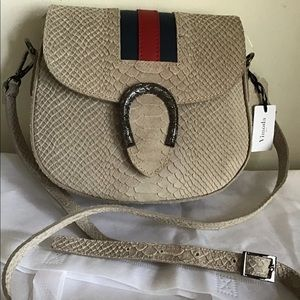 Italian leather crossbody bag snake print design